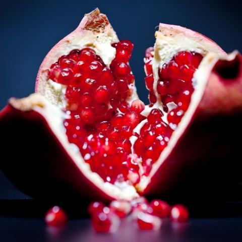 Bright red juicy pomegranate arils
