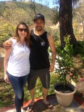 Young couple with patio lemon tree